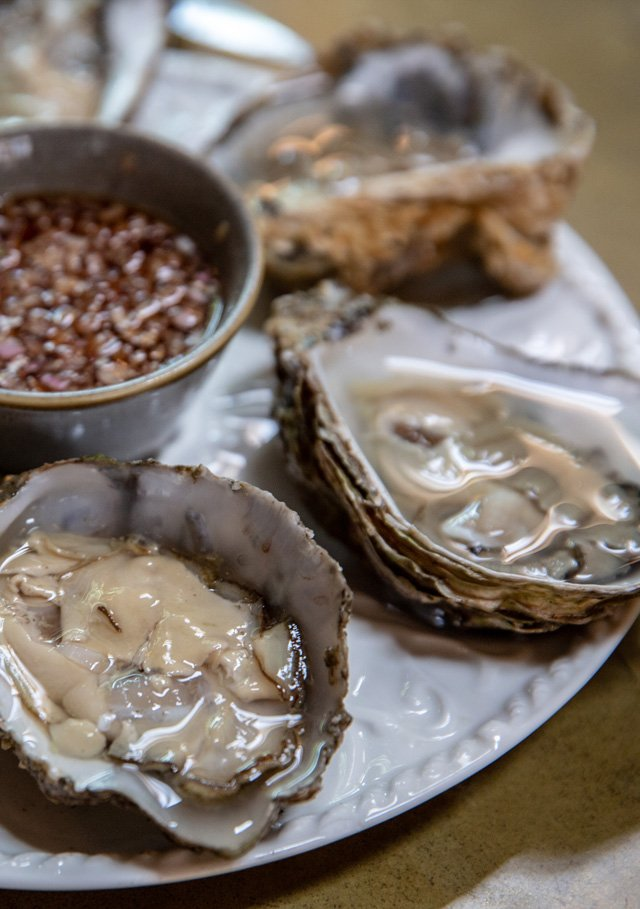 Rock oysters served with a cabernet sauvignon shallot dressing. Craft beer pub, Sussex.