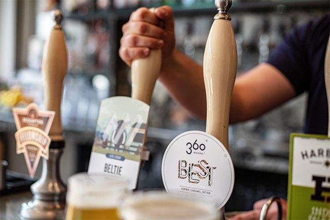 Cask ale pumps at a craft beer pub, Sussex.