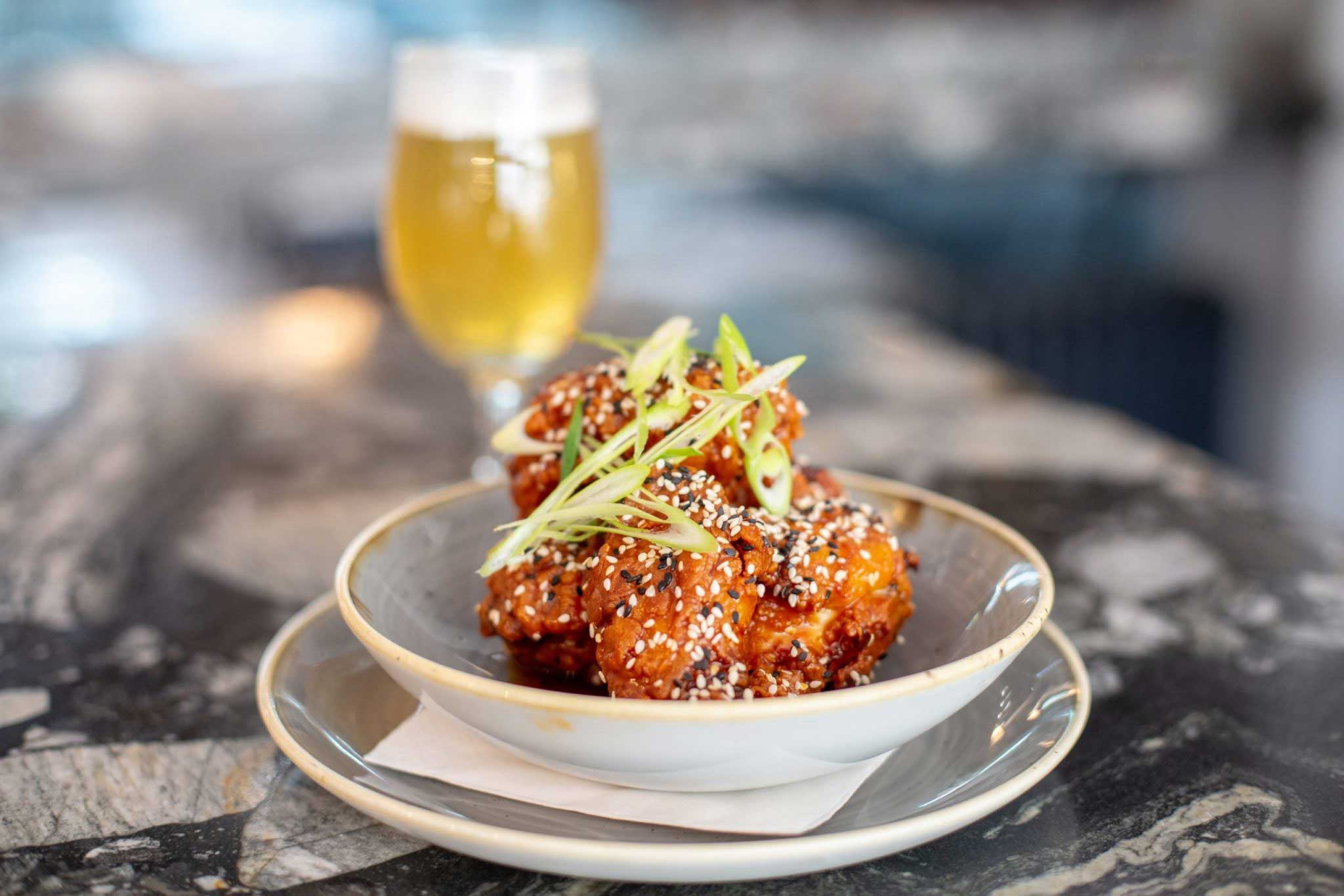 Korean Fried Spicy Chicken wings. Craft beer pub, Sussex.